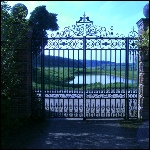 Decorative double gates including ornimental roses and robin