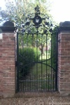 Single pedestrian gate with family crest detail